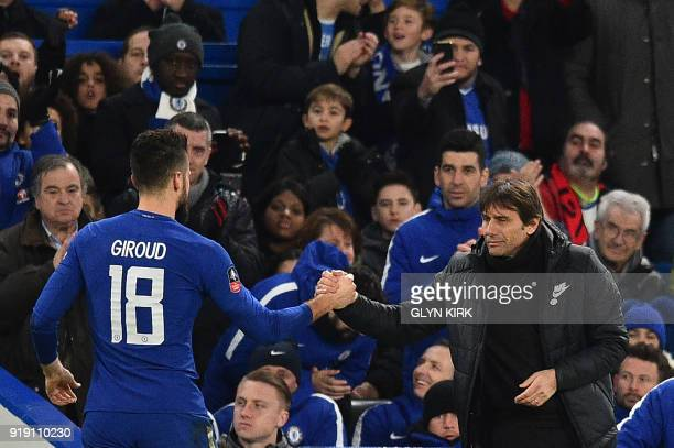 Chelsea's Italian head coach Antonio Conte greets Chelsea's French attacker Olivier Giroud on his substitution during the English FA Cup fifth round...
