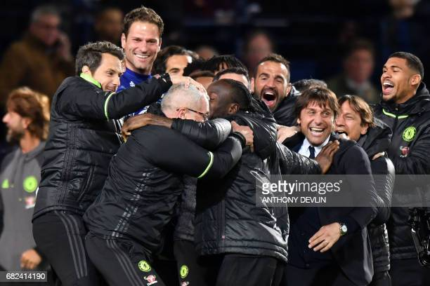 Chelsea's Italian head coach Antonio Conte leads celebrations of Chelsea's Belgian striker Michy Batshuayi scoring the opening goal during the...