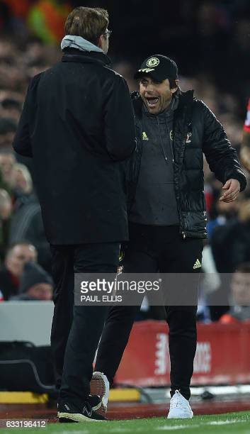 Chelsea's Italian head coach Antonio Conte react as he remonstrates with Liverpool's German manager Jurgen Klopp during the English Premier League...