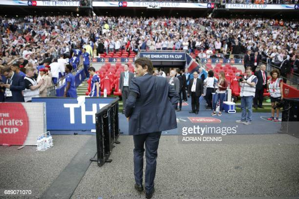 Chelsea's Italian head coach Antonio Conte reacts after their defeat to Arsenal after the English FA Cup final football match between Arsenal and...