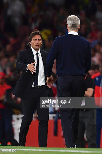 Chelsea's Italian head coach Antonio Conte shakes hands on the touchline with Arsenal's French manager Arsene Wenger at the end of the English...