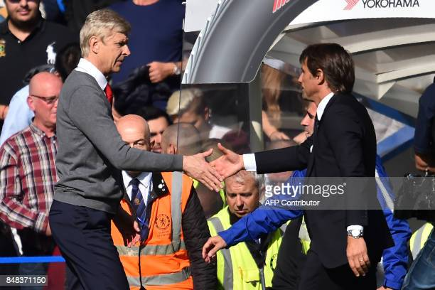 Chelsea's Italian head coach Antonio Conte shakes hands with Arsenal's French manager Arsene Wenger after the English Premier League football match...