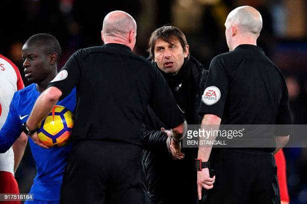 Chelsea's Italian head coach Antonio Conte shakes hands with referee Lee Mason at the end of the English Premier League football match between...