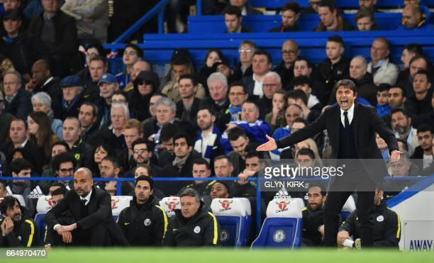 Chelsea's Italian head coach Antonio Conte shouts instructions to his players from the touchline as Manchester City's Spanish manager Pep Guardiola...