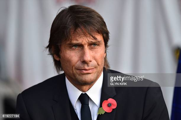 Chelsea's Italian head coach Antonio Conte takes his seat for the English Premier League football match between Southampton and Chelsea at St Mary's...