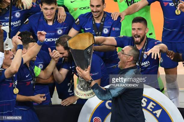 Chelsea's Italian head coach Maurizio Sarri and his players celebrate with the trophy after the UEFA Europa League final football match between...