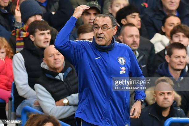 Chelsea's Italian head coach Maurizio Sarri gestures on the touchline during the English Premier League football match between Chelsea and Everton at...
