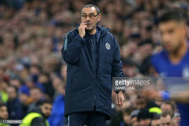Chelsea's Italian head coach Maurizio Sarri gestures on the touchline during the UEFA Europa League round of 32 2nd leg football match between...