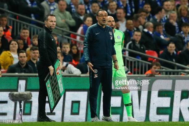 Chelsea's Italian head coach Maurizio Sarri reacts after Chelsea's Spanish goalkeeper Kepa Arrizabalaga remains on the pitch after an attempt to...