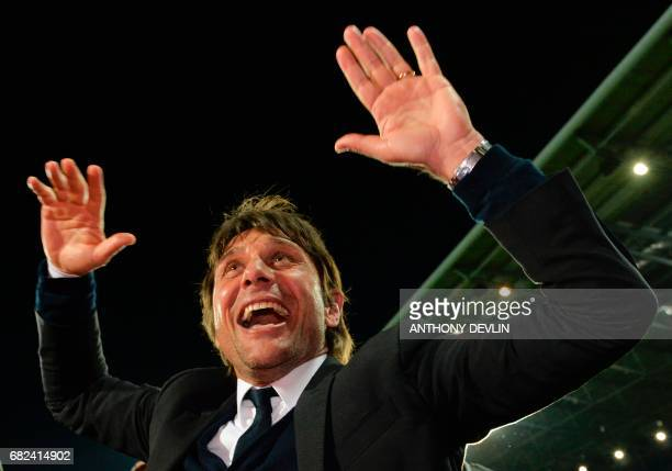 Chelsea's Italian manager Antonio Conte celebrates Chelsea being confirmed Premier League champions after the English Premier League match between...
