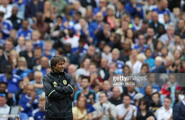 Chelsea's Italian manager Antonio Conte takes part in a training session at Chelsea's Stamford Bridge Stadium in London on August 10 ahead of the...