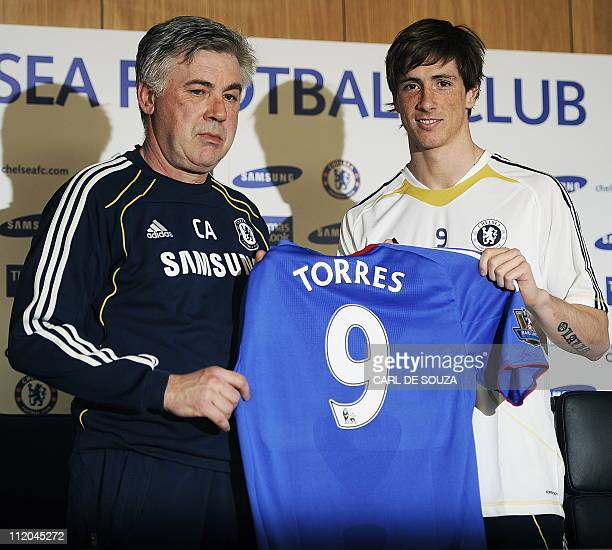 Chelsea's Italian Manager Carlo Ancelotti and new signing Spanish striker Fernando Torres pose for photographers during a press conference at...