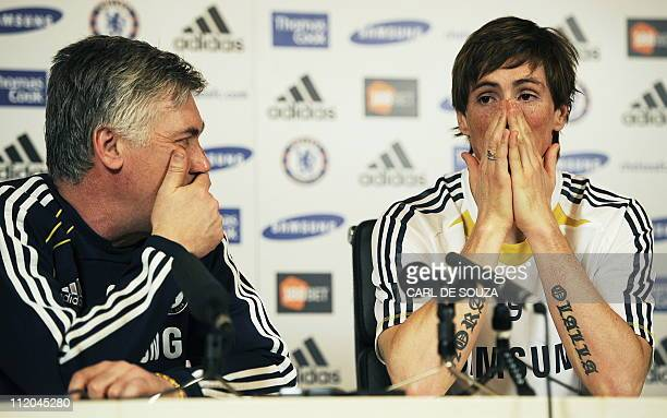 Chelsea's Italian Manager Carlo Ancelotti and new signing Spanish striker Fernando Torres attend a press conference at Chelsea's training grounds in...