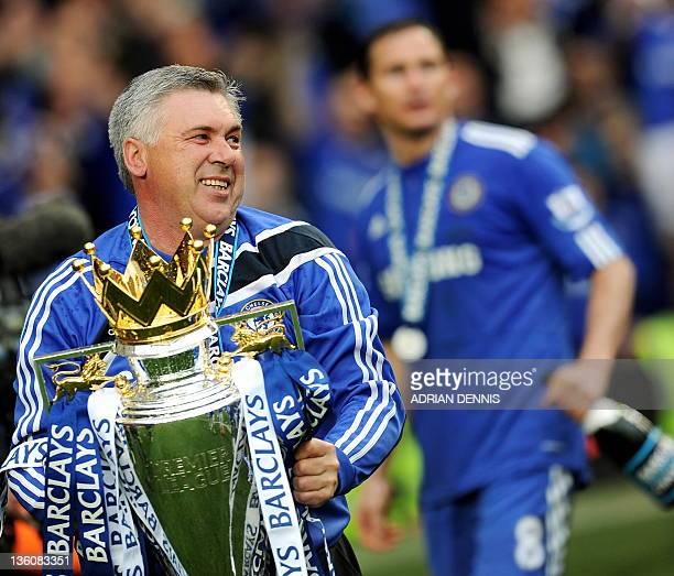 Chelsea's Italian manager Carlo Ancelotti celebrates with the Barclays Premier League trophy after Chelsea win the title with a 8-0 victory over...