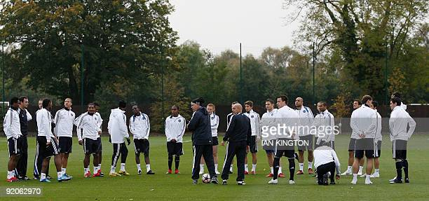 Chelsea's Italian Manager Carlo Ancelotti talks with the squad during a Chelsea training session on the eve of their Champions League Group D match...