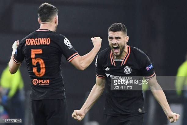 Chelsea's Italian midfielder Jorginho and Chelsea's Croatian midfielder Mateo Kovacic celebrate after winning at the end of the UEFA Champions League...