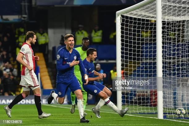 Chelsea's Italian midfielder Jorginho celebrates after scoring their first goal from the penalty spot during the UEFA Champion's League Group H...