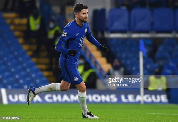 Chelsea's Italian midfielder Jorginho celebrates scoring from the penalty spot to score his team's equalising goal during the UEFA Champions League...