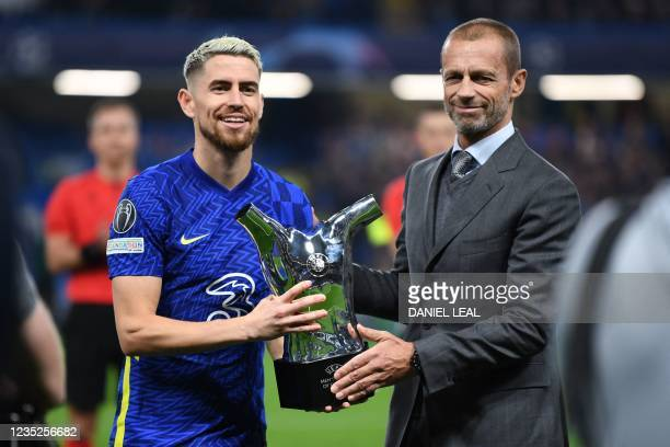 Chelsea's Italian midfielder Jorginho is presented with the UEFA men's player of the year award before the UEFA Champions League Group H football...