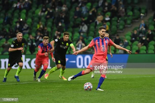 Chelsea's Italian midfielder Jorginho shoots from the penalty spot during the UEFA Champions League football match between Krasnodar and Chelsea at...