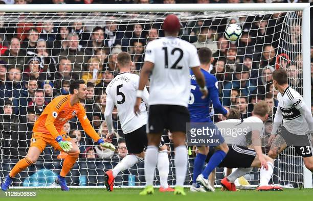 Chelsea's Italian midfielder Jorginho watches his shot beat Fulham's Spanish goalkeeper Sergio Rico for their second goal during the English Premier...