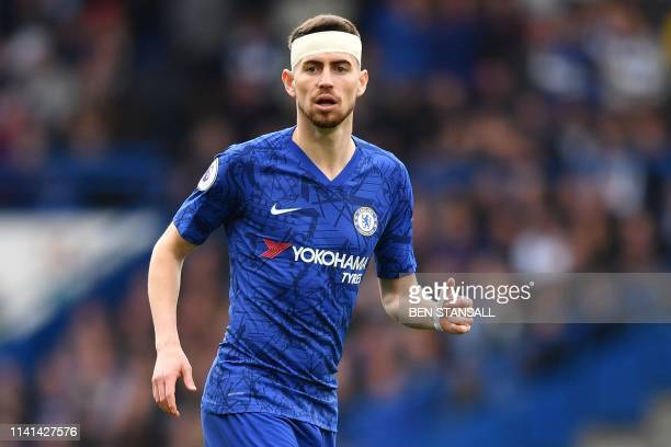 Chelsea's Italian midfielder Jorginho wears a bandage on his head during the English Premier League football match between Chelsea and Watford at...