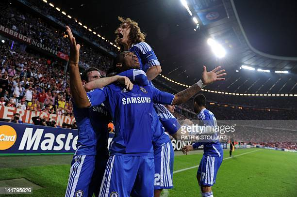Chelsea's Ivorian forward Didier Drogba celebrate with team mates after scoring a goal during the UEFA Champions League final football match between...