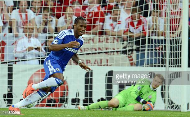 Chelsea's Ivorian forward Didier Drogba celebrates as Bayern Munich's German goalkeeper Manuel Neuer looks on after scoring the last penalty in the...