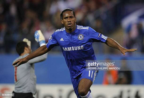 Chelsea's Ivorian forward Didier Drogba celebrates his second goal against Atletico Madrid during their Champions League football match at Vicente...