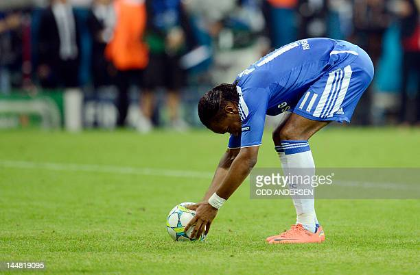 Chelsea's Ivorian forward Didier Drogba places his ball during the penalty session of the UEFA Champions League final football match between FC...