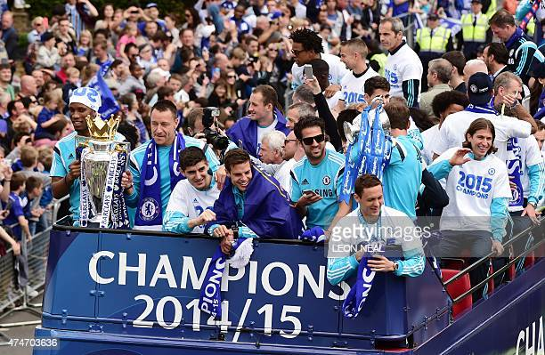 Chelsea's Ivorian striker Didier Drogba and Chelsea's English defender John Terry hold the Premier league trophy as they take part in an open top bus...