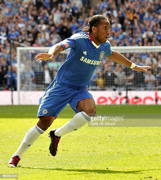 Chelsea's Ivorian striker Didier Drogba celebrates after scoring his team's first goal against Portsmouth during the FA Cup Final football match at...