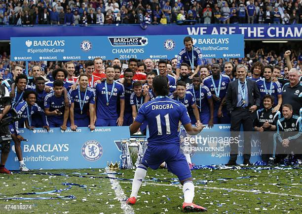 Chelsea's Ivorian striker Didier Drogba gestures to his teammates during the presentation of the Premier League trophy after the English Premier...