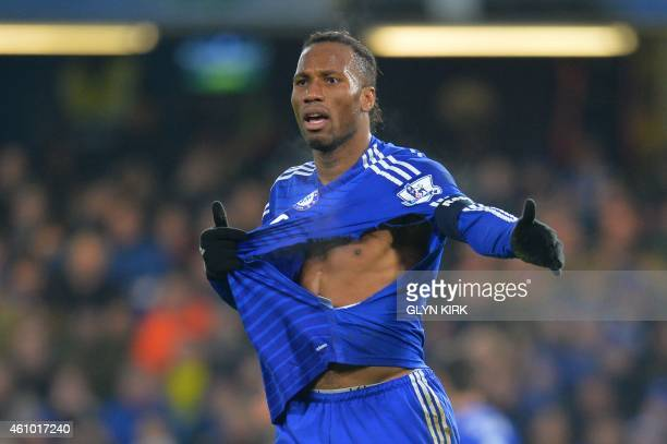 Chelsea's Ivorian striker Didier Drogba reacts as he walks on the pitch with a ripped shirt during the English FA Cup third round football match...