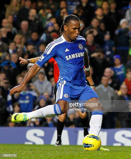 Chelsea's Ivorian striker Didier Drogba scores from the penalty spot during the English Premier League football match between Chelsea and Aston Villa...