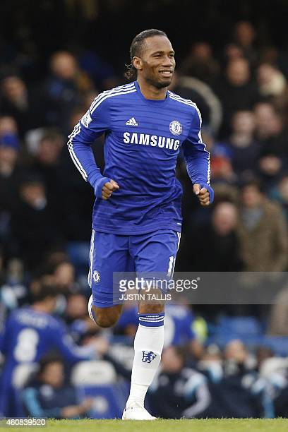 Chelsea's Ivorian striker Didier Drogba smiles as he comes on as a substitute during the English Premier League football match between Chelsea and...