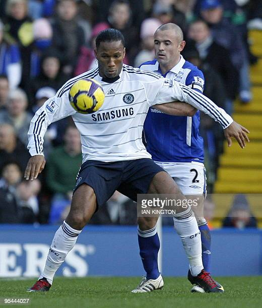 Chelsea's Ivorian striker Didier Drogba vies with Birmingham City's Irish defender Stephen Carr during the English Premier League football match...