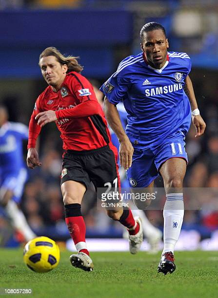 Chelsea's Ivorian striker Didier Drogba vies with Blackburn's Spanish defender Michel Salgado during the English Premier League football match...