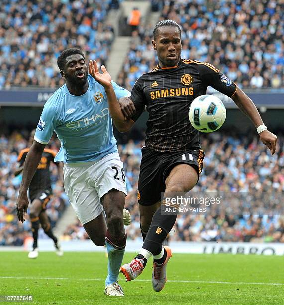 Chelsea's Ivorian striker Didier Drogba vies with Manchester City's Ivorian defender Kolo Toure during the English Premier League football match...