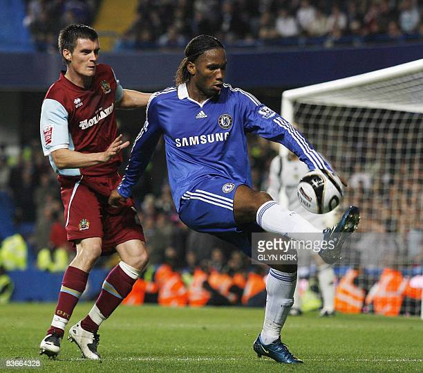 Chelsea's Ivory Coast Striker Didier Drogba vies with Burnley's English Defender Stephen Jordan during their Carling Cup 4th round match against...