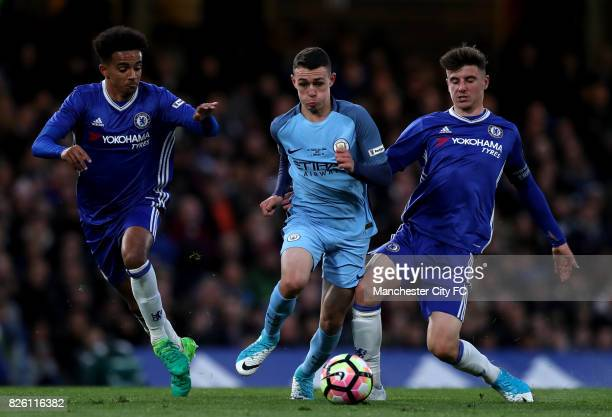 Chelsea's Jacob Maddox and Mason Mount Manchester City's Phil Foden battle for the ball
