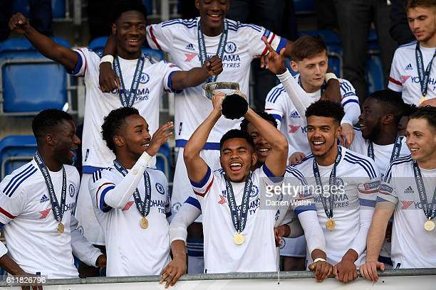Chelsea's Jay DaSilva celebrates with the trophy