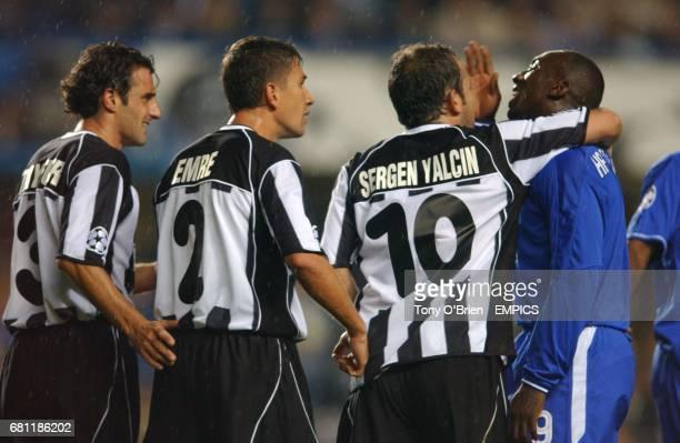 Chelsea's Jimmy Floyd Hasselbaink and Besiktas' goalscorer Sergen Yalcin in arguement during second half