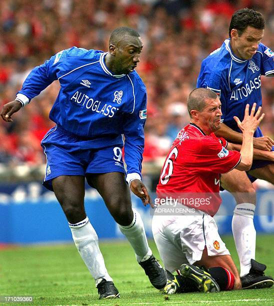 Chelsea's Jimmy Floyd Hasselbaink and Gustavo Poyet sandwich Manchester United's Roy Keane during the FA Charity Shield at Wembley stadium in London...