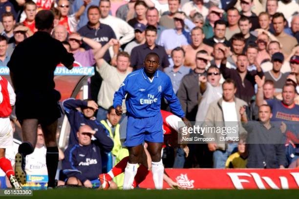 Chelsea's Jimmy Floyd Hasselbaink is sent off by referee Mike Riley after elbowing Arsenal's Martin Keown in the face