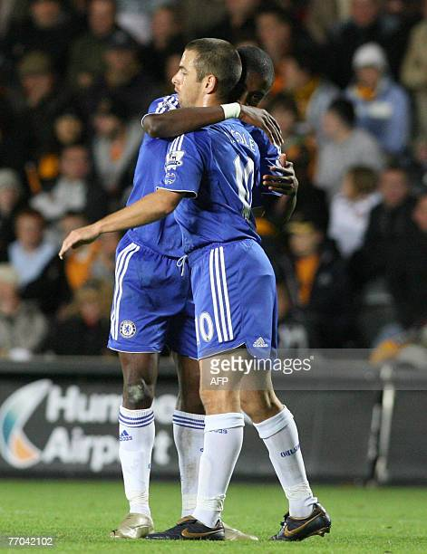Chelsea's Joe Cole congratulates Salomon Kalou on scoring their second goal against Hull City during a Carling Cup third round match at the KC...