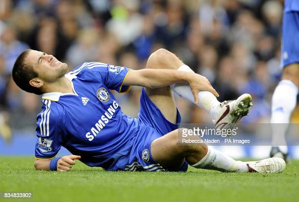 Chelsea's Joe Cole holds his ankle after a challenge