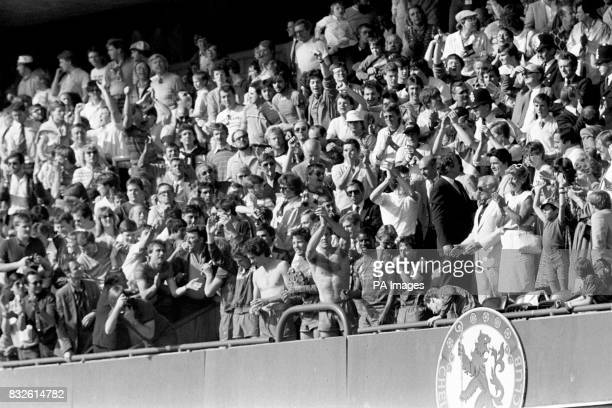 Chelsea's Joey Jones Colin Lee Joey McLaughlin Kerry Dixon Paul Canoville and Mickey Thomas salute the fans from the front row of the directors' box...
