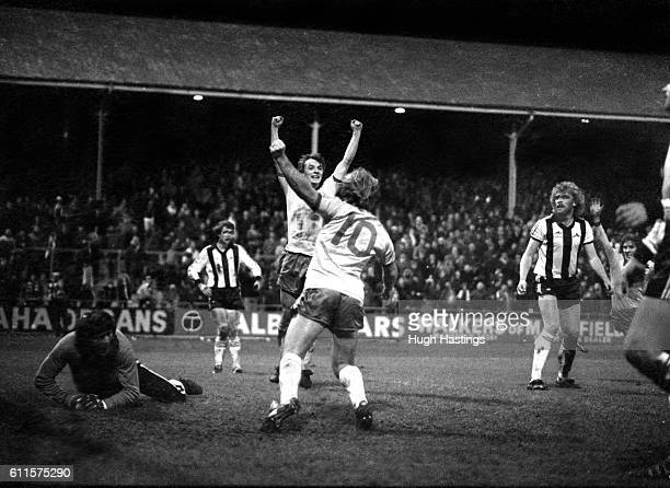 Chelsea's John Bumstead celebrates his goal with Clive Walker