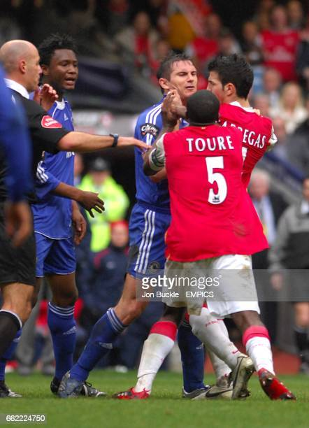 Chelsea's John Mikel and Arsenal Kolo Toure come to blows resulting both players being show the red card as Chelsea's Frank Lampard and Arsenal's...